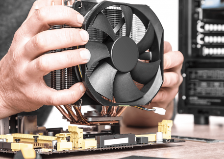 technician fixing computer fan