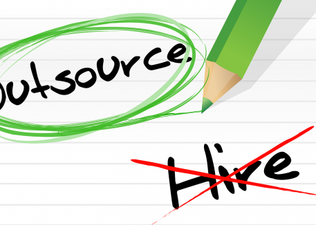 notecard with outsource circled and hire crossed out