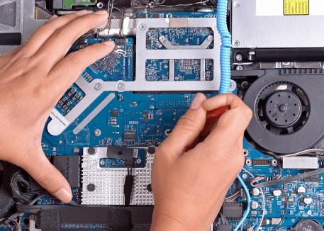 technician repairing macbook motherboard