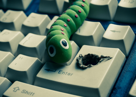 virus crawling out of keyboard