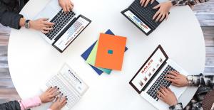 customers testing laptops