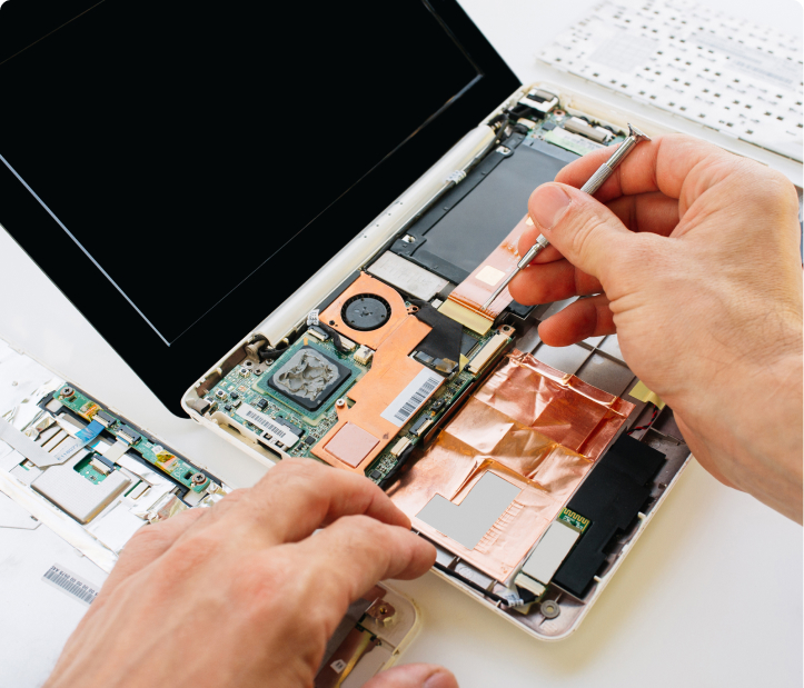 man repairing insides of laptop