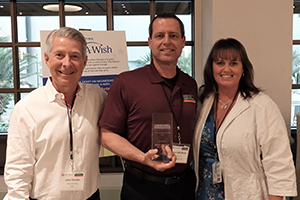 bryan windham receiving 2019 annual conference award