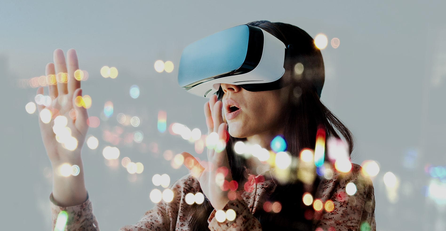 woman uses futuristic augmented reality headset