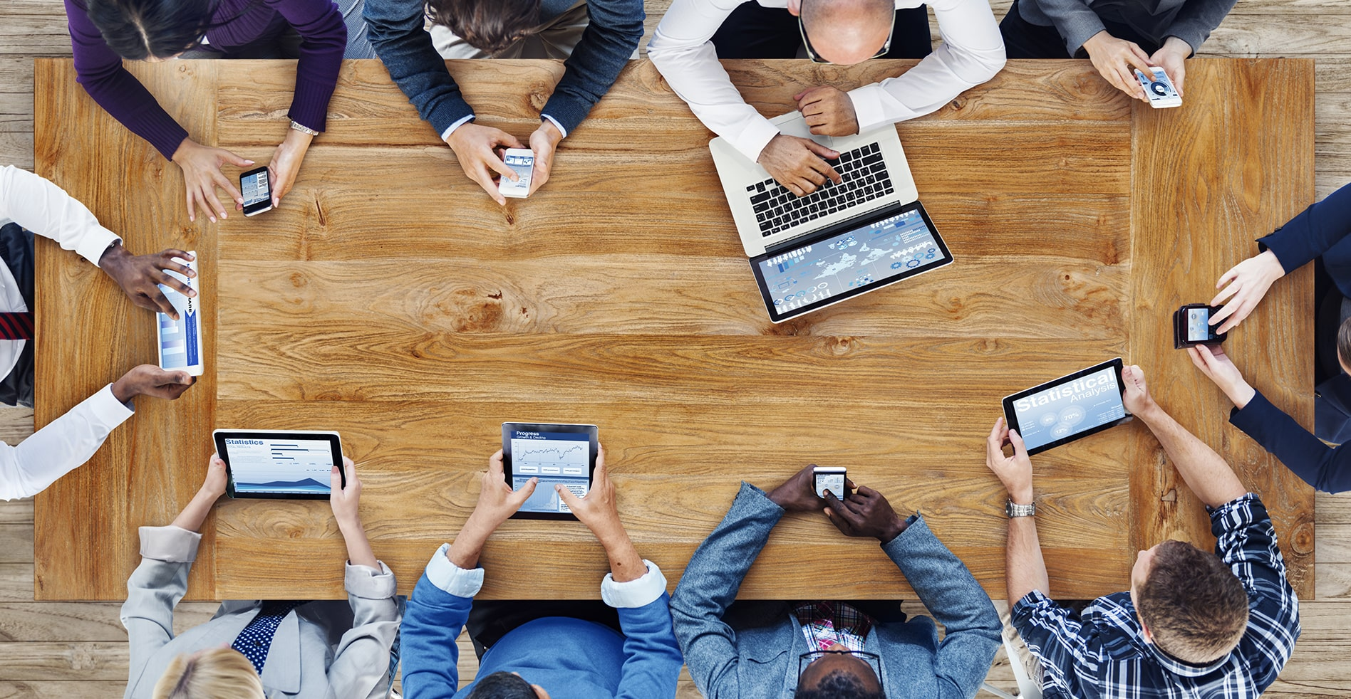 overhead view of small business using it support for their technology